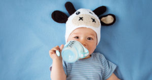baby in bed with bottle dental advice