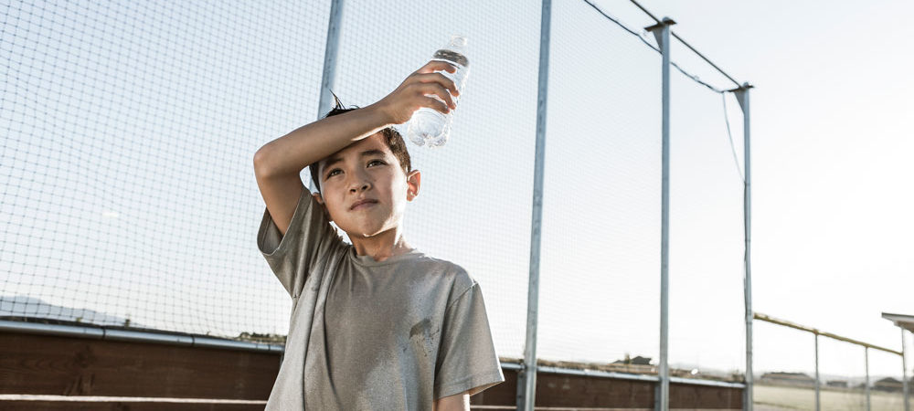 kid dehydrated with water