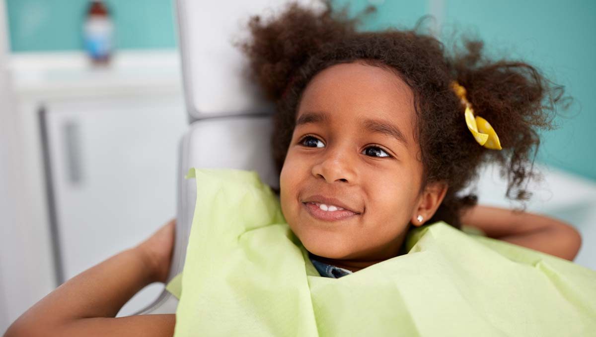 tooth extraction girl pediatric dentist